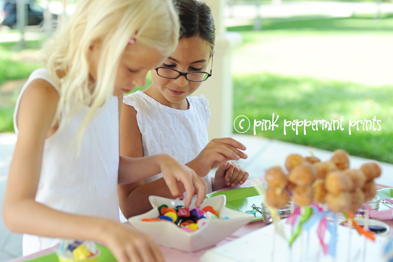 Cute girls making button bracelets at art and crafts party for girls lots of party ideas and tutorials