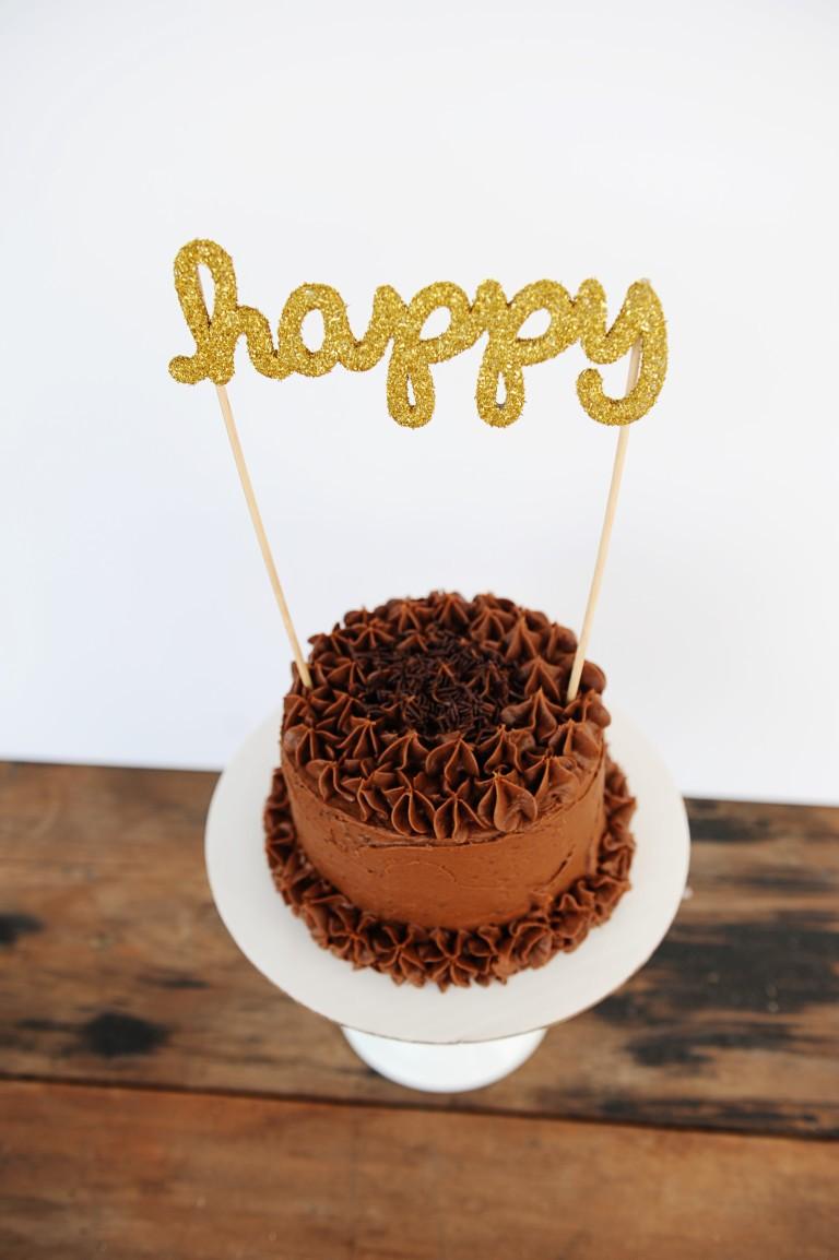 Happy glittered cake topper